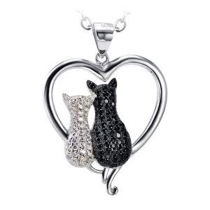 Silver Chain with Black & White Zirconia Cats sitting in a Silver Heart