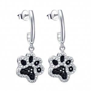 Silver dog paw earrings with black and white zirconia stones